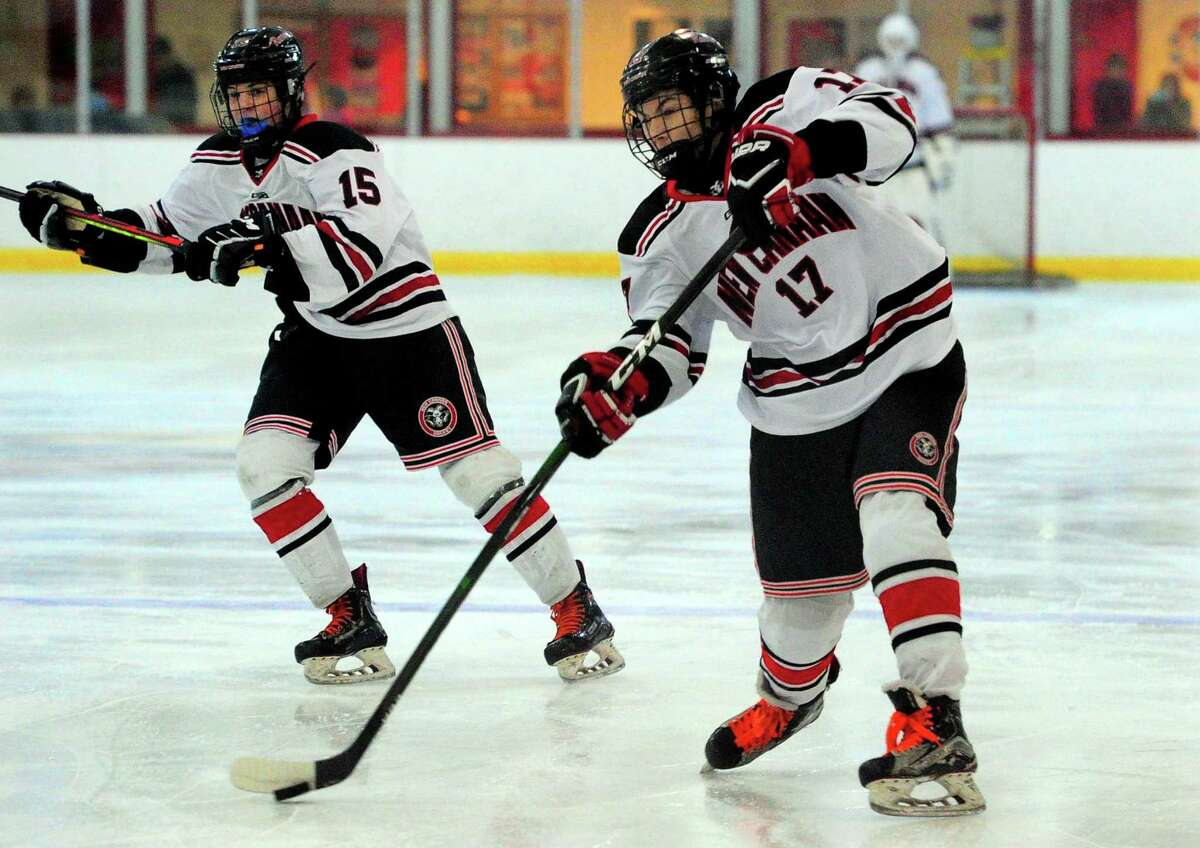 New Canaan's Justin Wietfeldt (17) hits a slap shot during FCIAC boys hockey championship action against Darien in Greenwich, Conn., on Saturday Mar. 7, 2020.