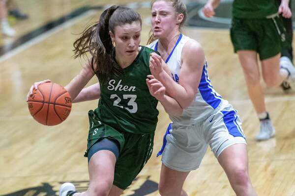 Shenendehowa junior Meghan Huerter drives to the basket in front of Saratoga junior Abby Ray in the in the Section II, Class AA finals at Hudson Valley Community College in Troy NY on Saturday, March 7, 2020 (Jim Franco/Special to the Times Union.)