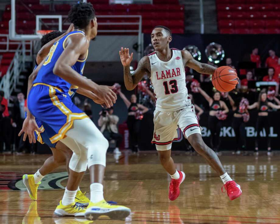 Davion Buster (13) brings the ball up court in the second half. The Lamar Cardinals came back to tie up the game against the McNeese Cowboys on March 7, 2020 but lost the season finale in the final seconds of the contest.  Fran Ruchalski/The Enterprise Photo: Fran Ruchalski/The Enterprise / 2019 The Beaumont Enterprise