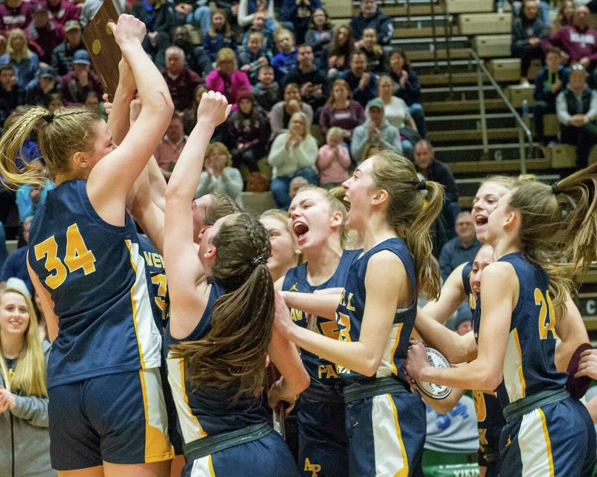 The Averill Park girls' basketball team was in a celebratory mood when it won the Section II, Class A championship last year at Hudson Valley Community College. The Warriors are likely to get to resume practice on Feb. 1 because Rensselaer County has given the go-ahead to high-risk sports to resume on that date. (Jim Franco/Times Union archive)