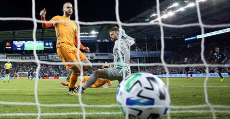 KANSAS CITY, KANSAS - MARCH 07: Goalkeeper Marko Maric #1 and Aljaz Struna #5 of Houston Dynamo let in a goal during the game against Sporting Kansas City at Children's Mercy Park on March 07, 2020 in Kansas City, Kansas. (Photo by Jamie Squire/Getty Images)