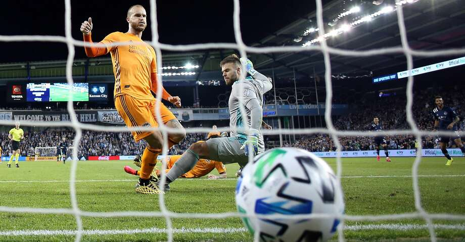 KANSAS CITY, KANSAS - MARCH 07: Goalkeeper Marko Maric #1 and Aljaz Struna #5 of Houston Dynamo let in a goal during the game against Sporting Kansas City at Children's Mercy Park on March 07, 2020 in Kansas City, Kansas. (Photo by Jamie Squire/Getty Images) Photo: Jamie Squire/Getty Images