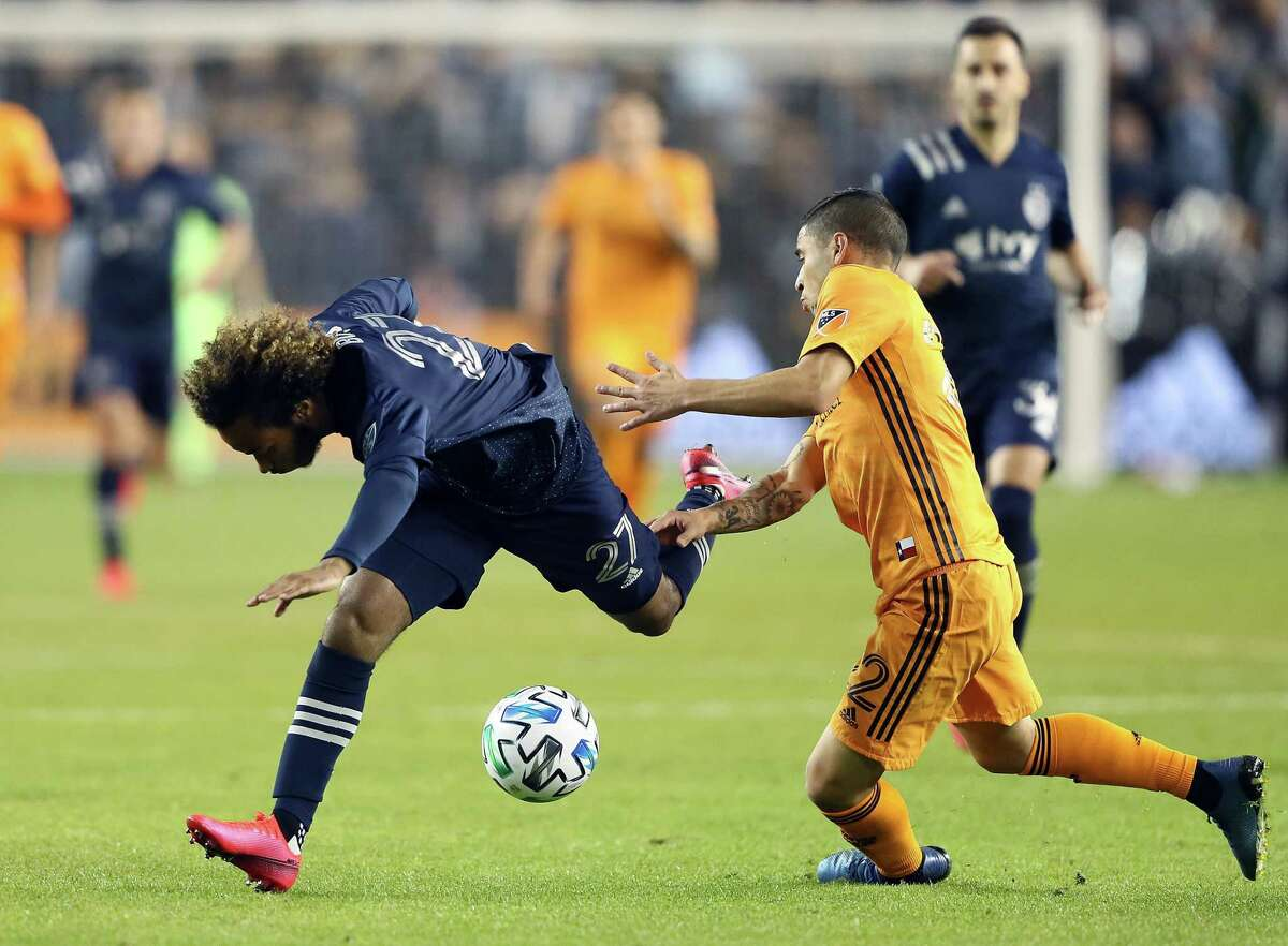 KANSAS CITY, KANSAS - MARCH 07: Gianluca Busio #27 of Sporting Kansas City is tripped by Matias Vera #22 of Houston Dynamo during the game at Children's Mercy Park on March 07, 2020 in Kansas City, Kansas. (Photo by Jamie Squire/Getty Images)