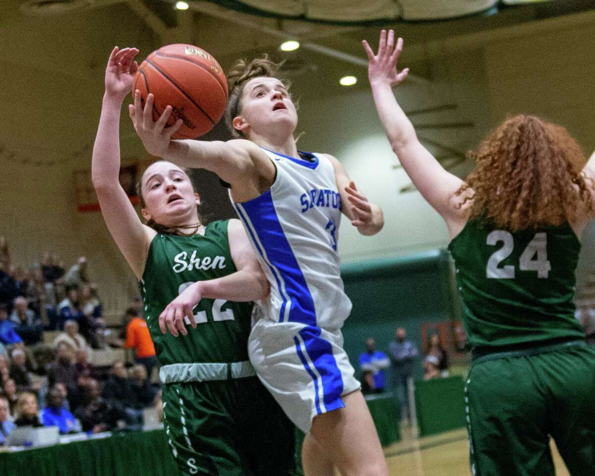 Saratoga senior Dolly Cairns drives to the basket in front of Shenendehowa senior Kaitlyn Watrobski (22) and senior Bella Stuart (24) in the Section II, Class AA finals at Hudson Valley Community College in Troy NY on Saturday, March 7, 2020 (Jim Franco/Special to the Times Union.)