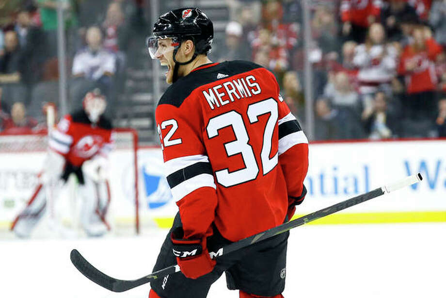 New Jersey Devils defenseman Dakota Mermis, an Alton native and a graduate of Alton High, celebrates his goal during the second period Friday night against the Blues, the favorite team of his childhood. It was his first NHL goal. Photo: AP Photo