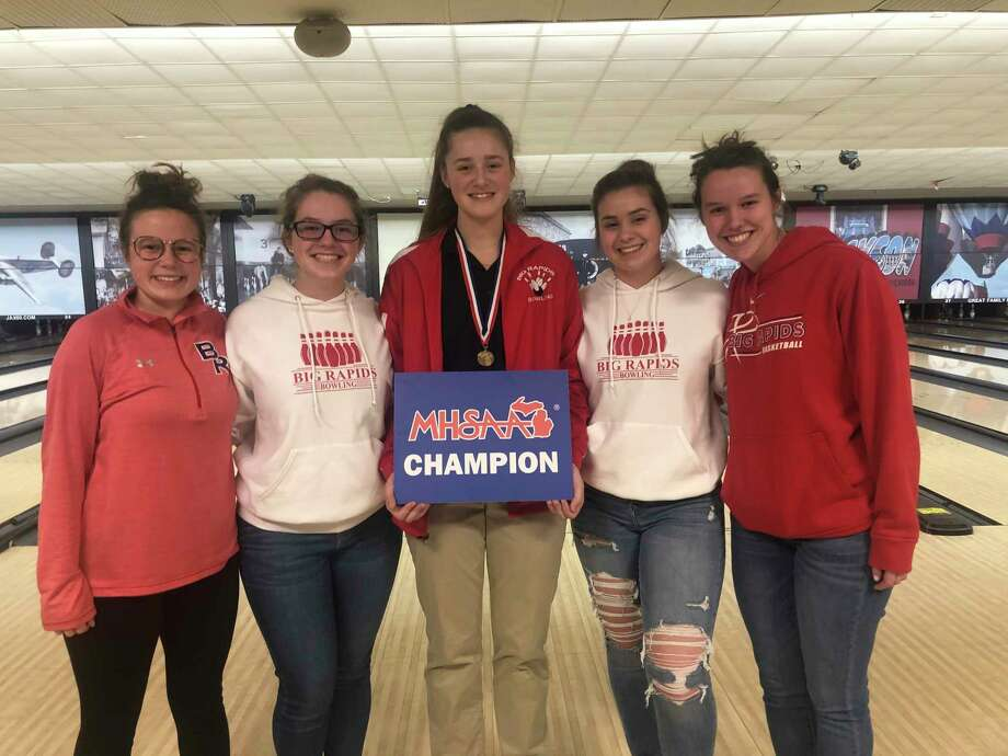 Hope Thebo is congratulated by her teammates after winning the Division 3 state title on Saturday: from left. Lauren Posey, Emily Mathewson, Hope Thebo, Rheanna Swinson and Chloe Mathewson. (Courtesy photo)