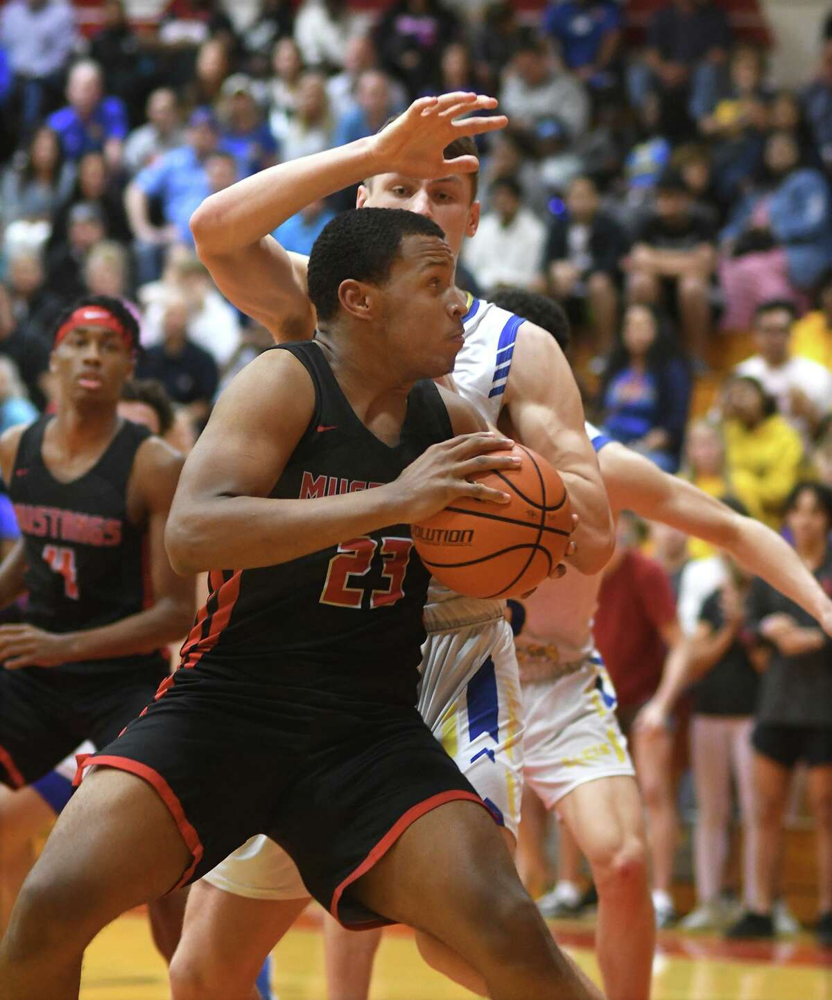 Westfield sophomore Willie Williams (23) works for a shot against Klein junior post Mason Tharp during the second quarter of their Boys Basketball Region II-6A Quarterfinal playoff game at Tomball High School on March 3, 2020.
