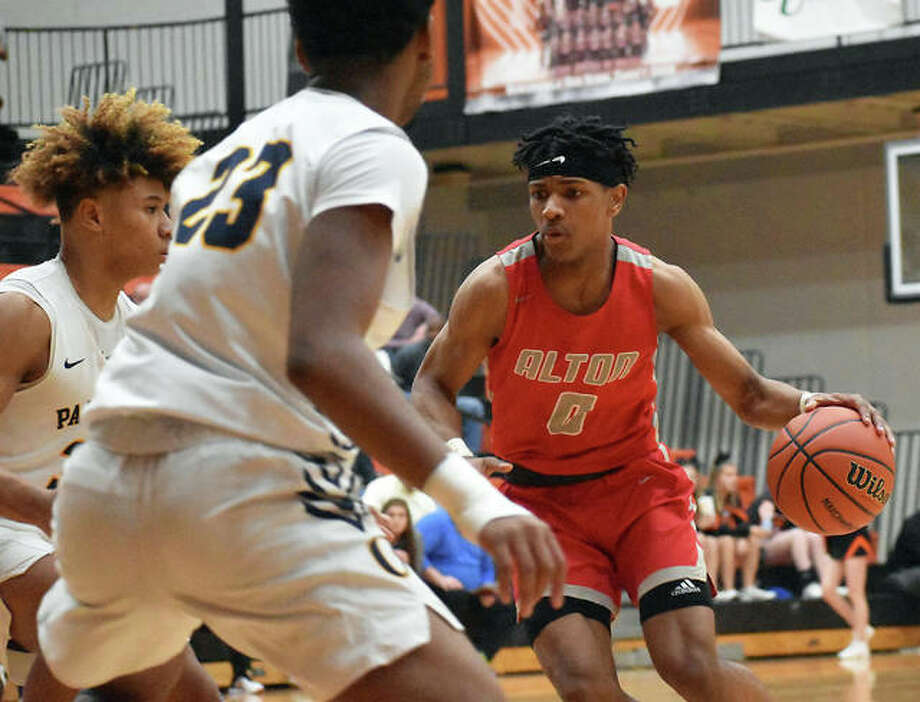 Alton's Moory Woods (right) handles the ball in Tuesday's Class 4A regional semifinal game against O'Fallon at Lucco-Jackson Gym in Edwardsville. Woods is one of seven seniors the Redbirds will graduate from a 13-18 squad. Photo: Matt Kamp / Hearst Midwest