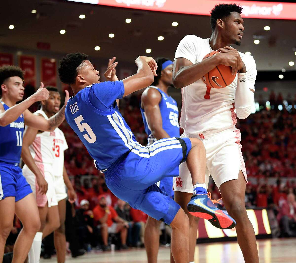Houston center Chris Harris Jr. (1) rips the ball away from Memphis guard Boogie Ellis (5) during the first half of an NCAA college basketball game, Sunday, March 8, 2020, in Houston.