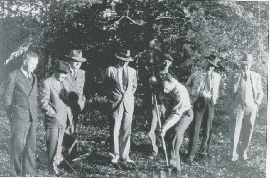 Groundbreaking for the new Midland Hospital took place in 1942 with Phil Rich, president of the Hospital Association, digging the first ceremonial shovel of dirt. Pictured from left are E.F. Holser, Martin Maxwell, Jacob Michel, Wayne McCandless, Aaron T. Bliss, Karl Sipple and Ralph Murray. (Photo provided)