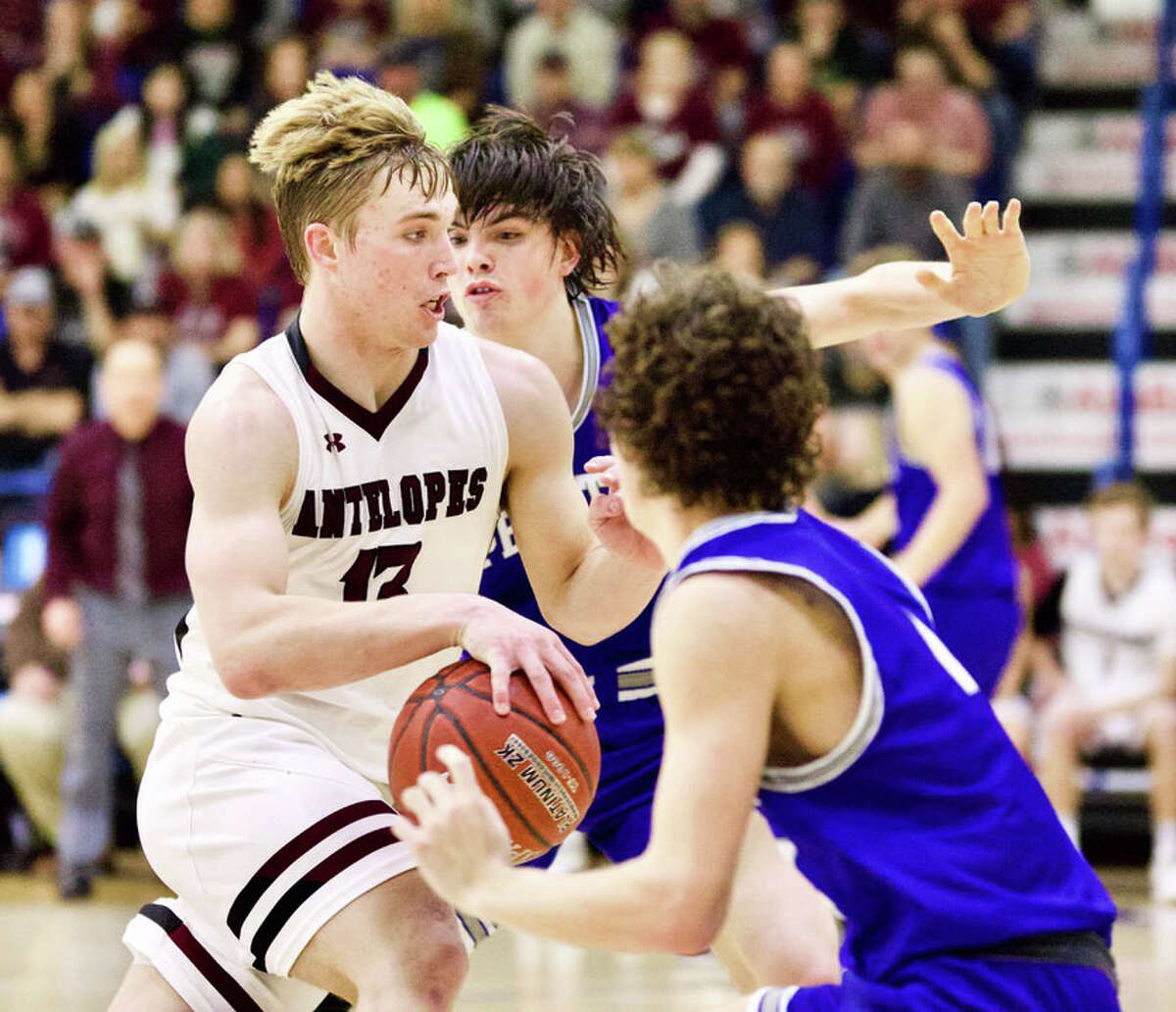 Abernathy's Bryson Daily drives past a pair of Peaster defenders during their Region 1-3A region semifinal boys basketball game on Friday at Lubbock Christian University.