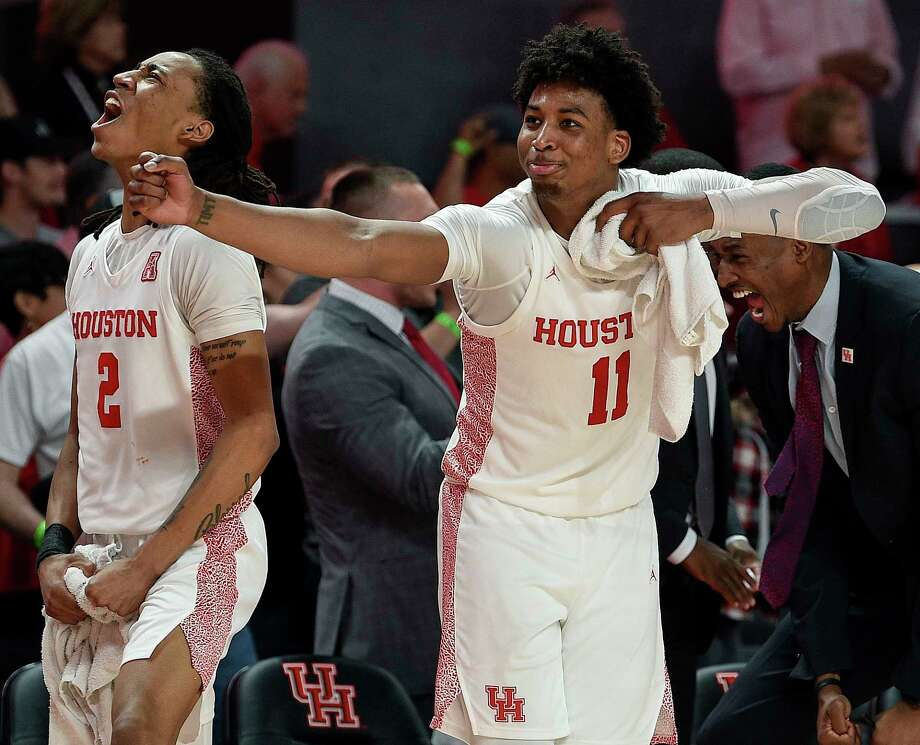 Houston guard Nate Hinton (11) celebrates a Memphis turnover with guard Caleb Mills (2) during the second half of an NCAA college basketball game, Sunday, March 8, 2020, in Houston. Photo: Eric Christian Smith, Contributor / Houston Chronicle