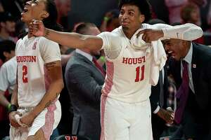 Houston guard Nate Hinton (11) celebrates a Memphis turnover with guard Caleb Mills (2) during the second half of an NCAA college basketball game, Sunday, March 8, 2020, in Houston.