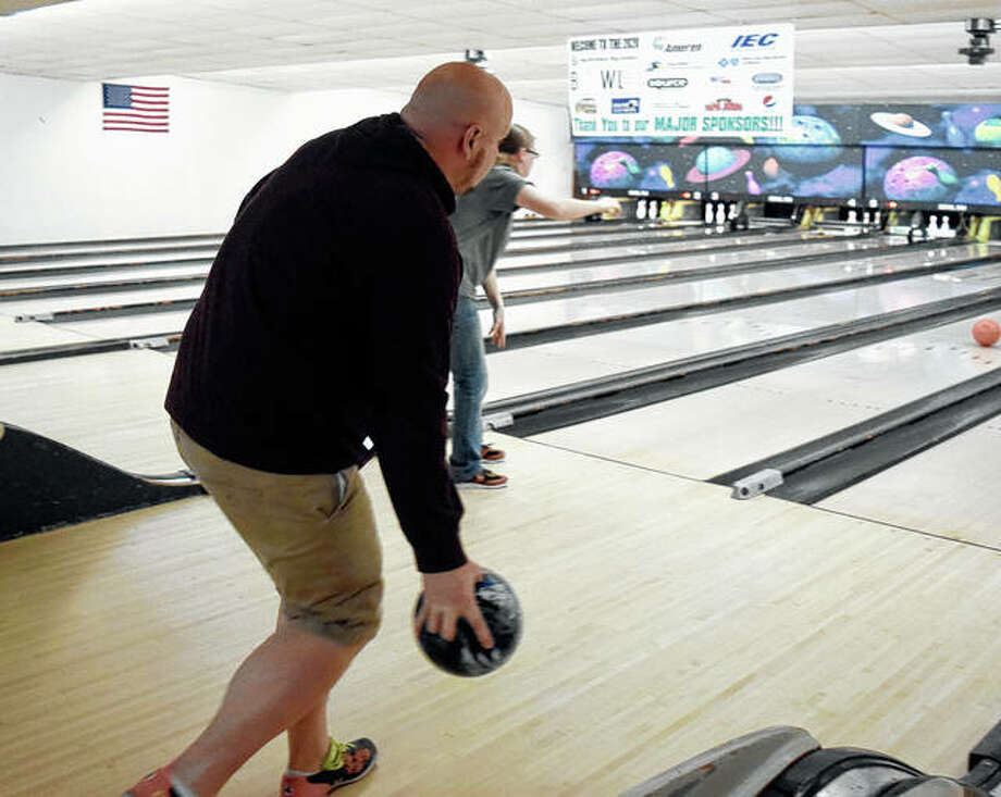 Matt Frost of Jacksonville gets ready to let go of his bowling ball during Big Brothers Big Sisters of West Central Illinois Bowl For Kids Sake fundraising event. The event was revived after the organization's brief closure prevented the fundraiser from taking place last year.