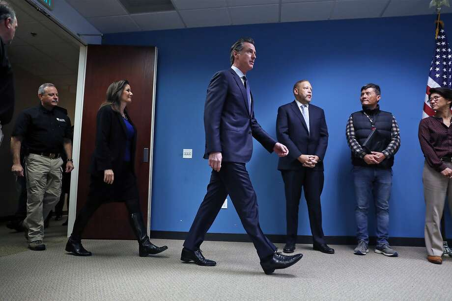 Gov. Gavin Newsom (center) recently touted a surplus, but the coronavirus now complicates the state's budget planning. Photo: Scott Strazzante / The Chronicle