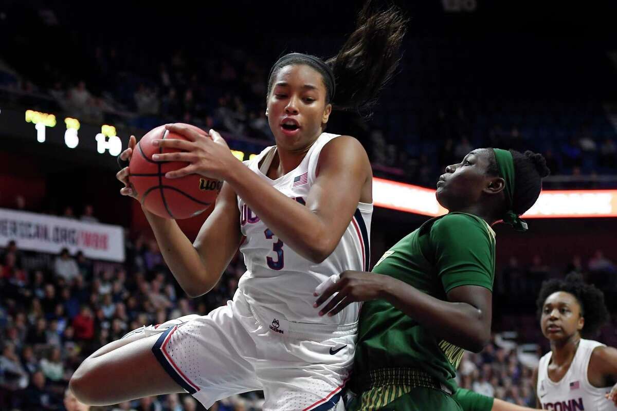 UConn's Megan Walker (3) was named a First Team All-American by the U.S. Basketball Writers Association on Monday.