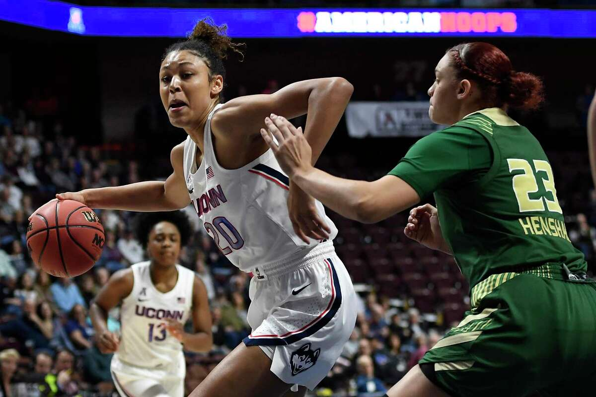 UConn's Olivia Nelson-Ododa, left, drives around South Florida's Tamara Henshaw during a game last season at Mohegan Sun Arena in Uncasville.