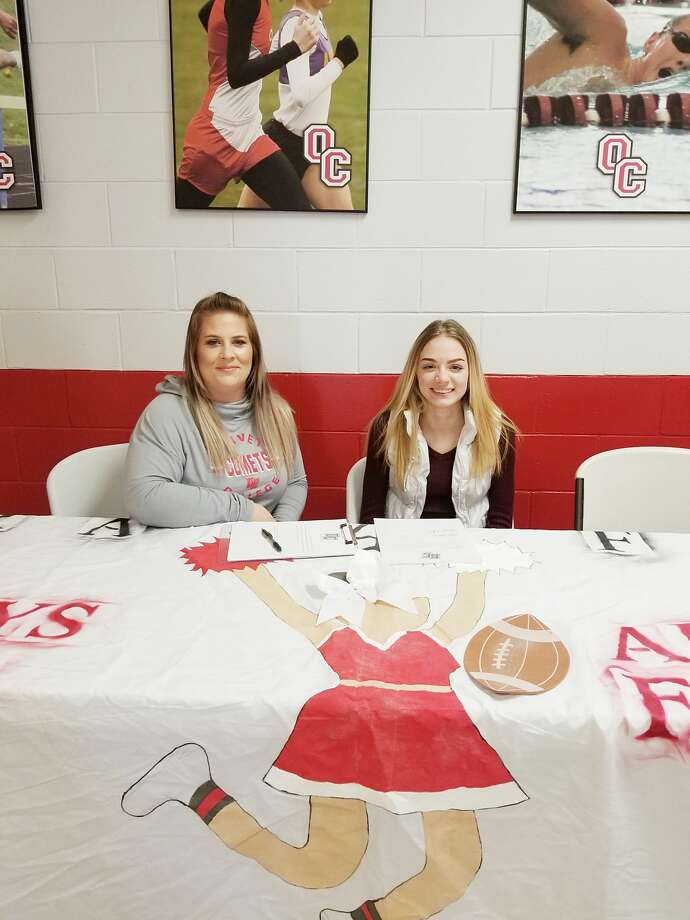 Brethren senior Alexis Adkins (right) is pictured alongside Olivet coach Lisa Ash as Adkins signs her letter of intent to cheer at Olivet College next fall. Photo: Courtesy Photo