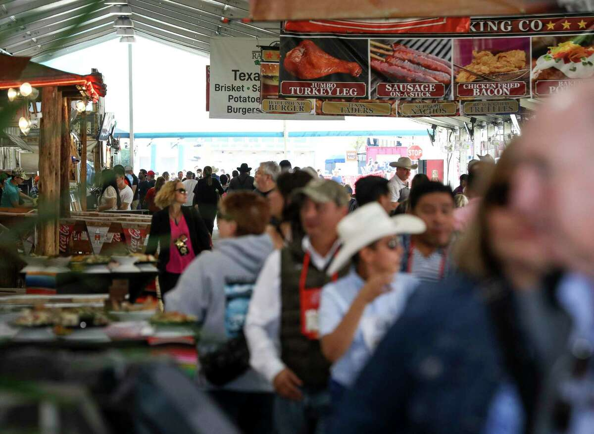 People look for food at the Houston Livestock Show and Rodeo on Thursday, March 5, 2020, at NRG Stadium in Houston.
