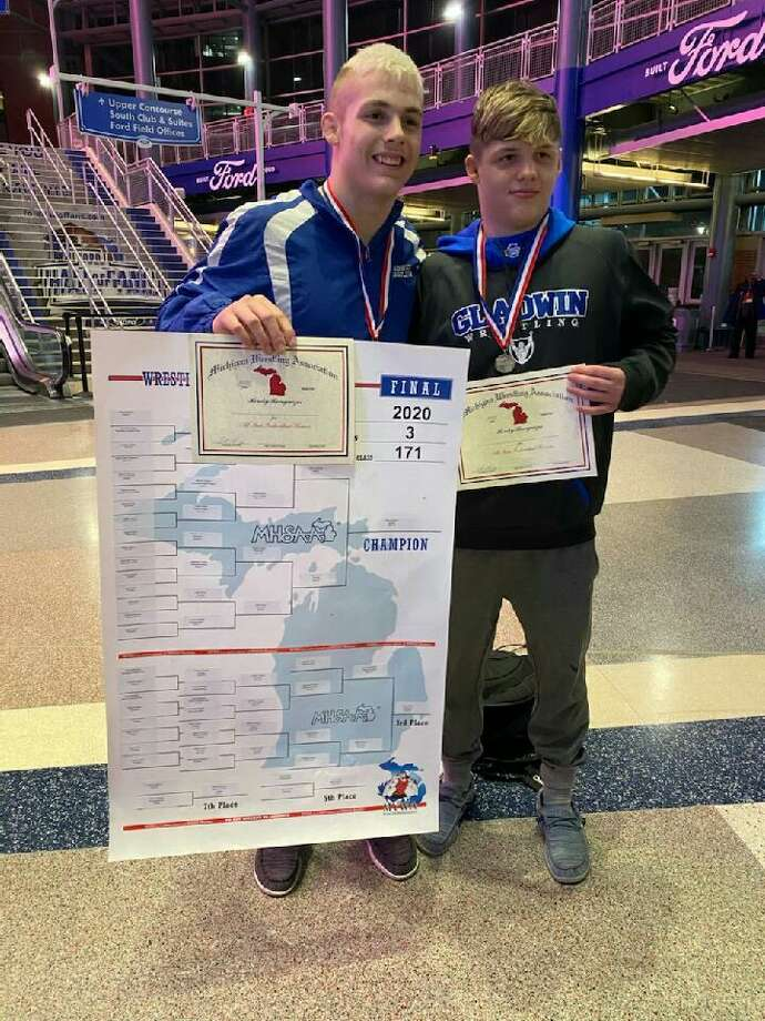 Gladwin's Dillon Kroening (left) and Randy Pyrzewski pose with their medals and certificates after Kroening won the state championship at 171 pounds and Pyrzewski finished as runner-up at 160 pounds at the Division 3 individual wrestling state finals at Ford Field in Detroit. Photo: Photo Provided