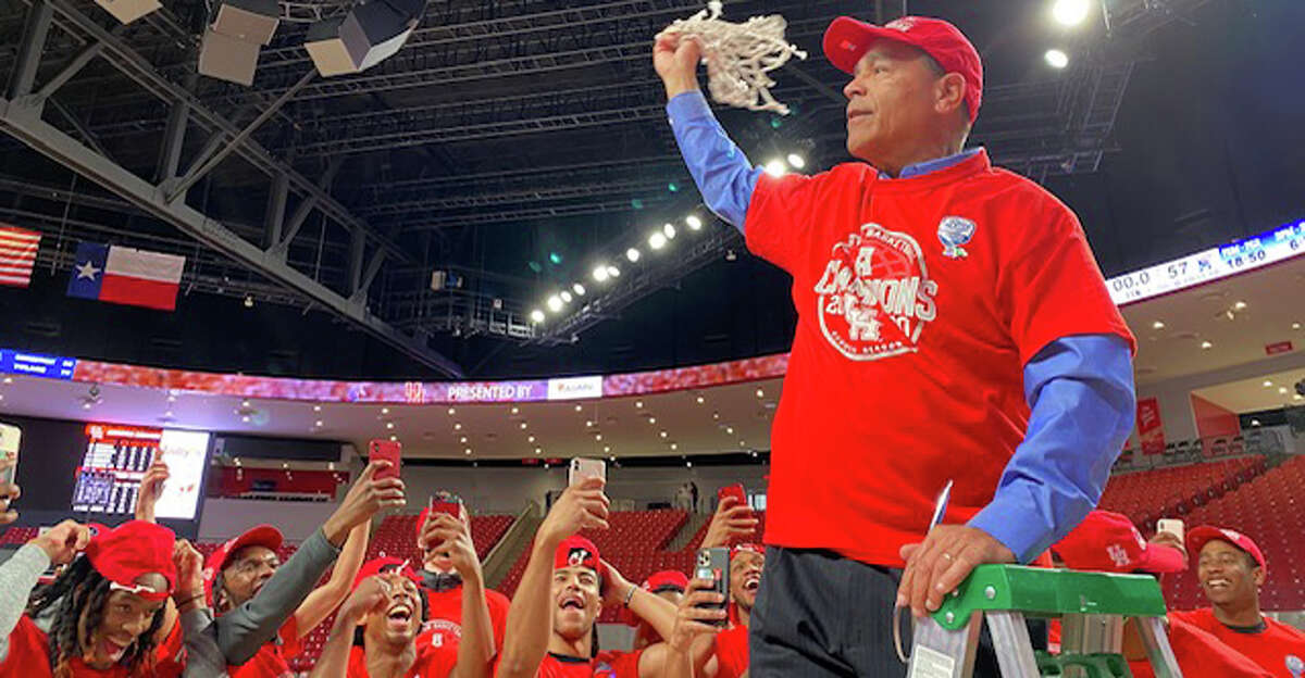 Coach Kelvin Sampson and the University of Houston men's basketball team celebrate clinching a share of the American conference title.