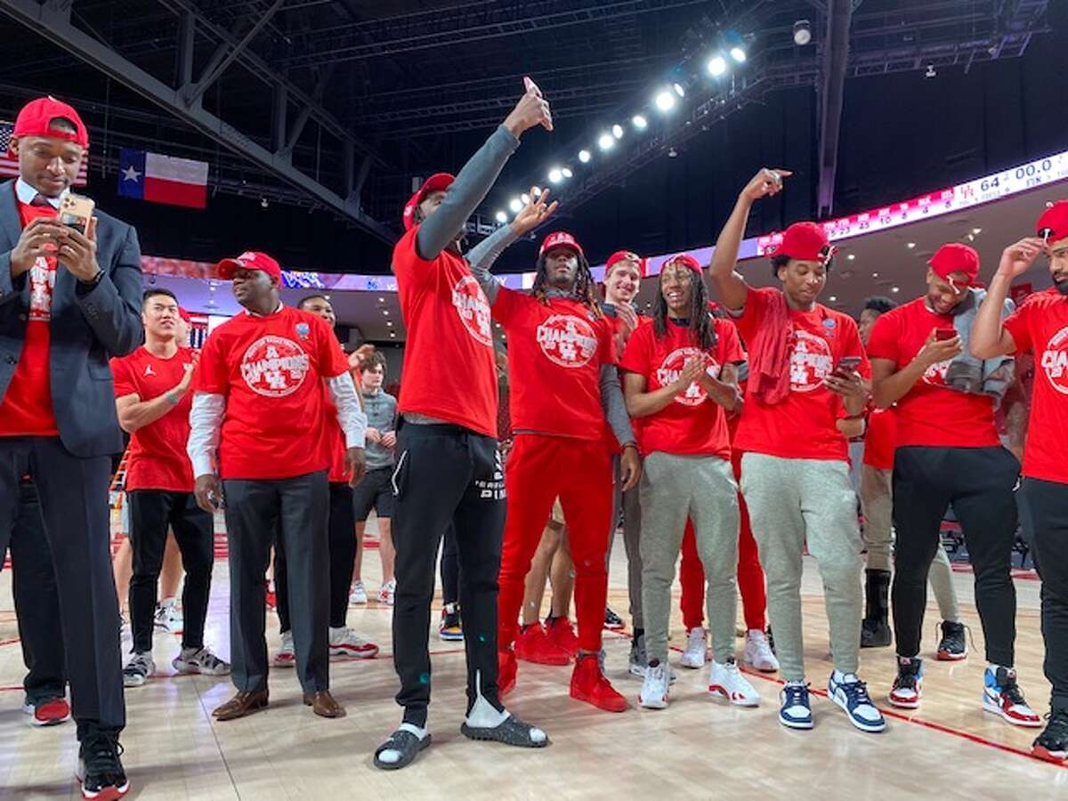The University of Houston men's basketball team celebrates clinching a share of the American conference title.