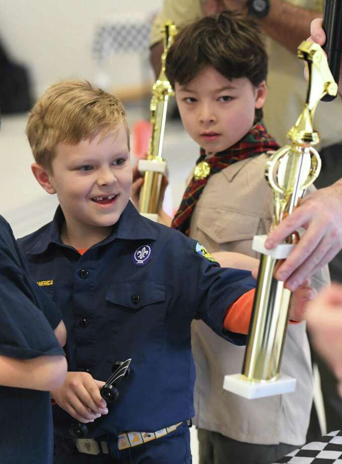 Photos from the Greenwich Boy Scouts Pinewood Derby Championship at Miller Motorcars showroom in Greenwich, Conn. Sunday, March 8, 2020. Scouts built their cars by hand according to specific guidelines either at home or during the Pinewood Derby workshop in January. 21 competitors battled as cars' times were digitally tracked in multiple heats, allowing the fastest cars to advance to a championship bracket of eight. James Henry won first place overall and Jacob Tirana won Best in Show for his car design. Photo: Tyler Sizemore / Hearst Connecticut Media / Greenwich Time