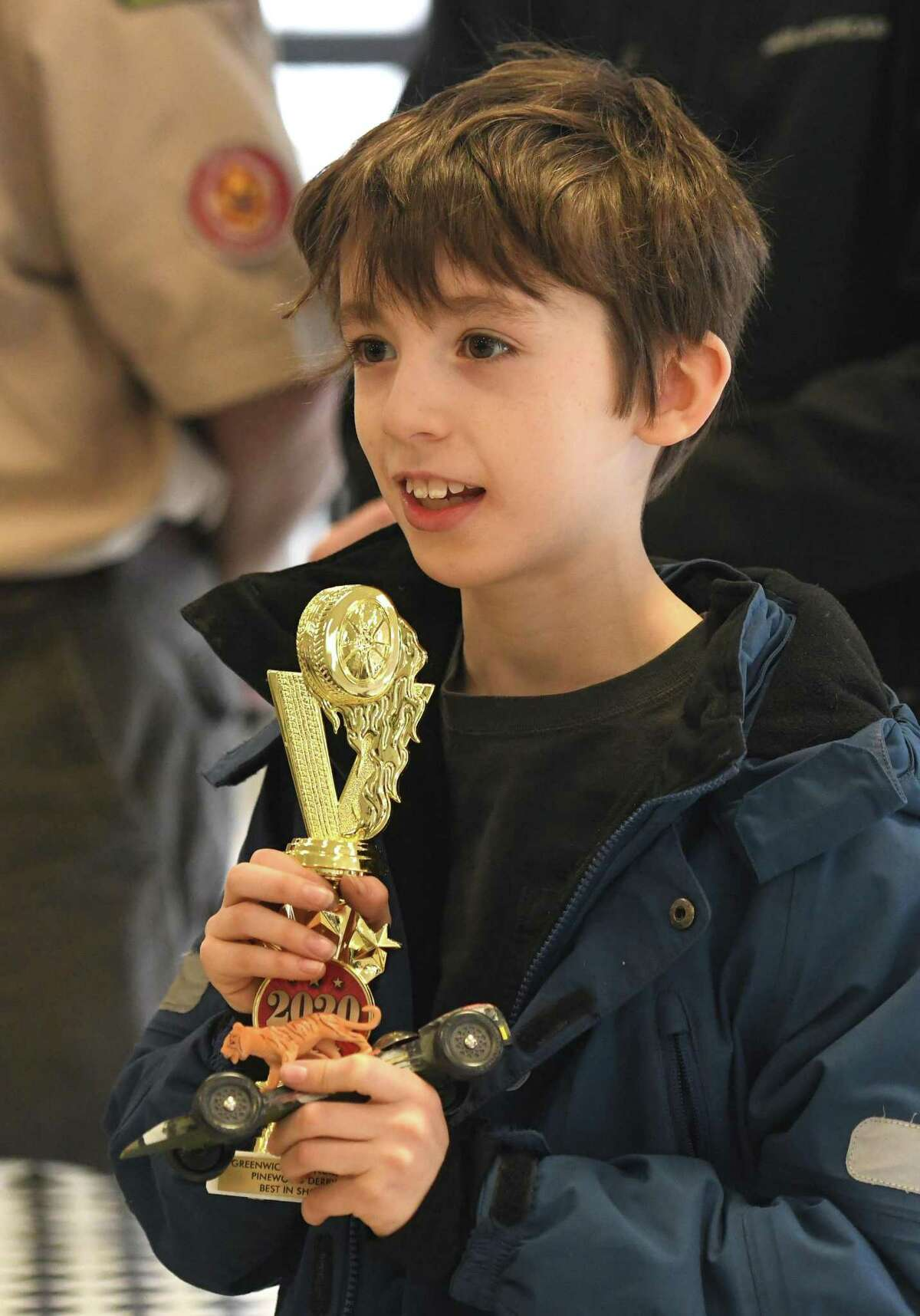 Photos from the Greenwich Boy Scouts Pinewood Derby Championship at Miller Motorcars showroom in Greenwich, Conn. Sunday, March 8, 2020. Scouts built their cars by hand according to specific guidelines either at home or during the Pinewood Derby workshop in January. 21 competitors battled as cars' times were digitally tracked in multiple heats, allowing the fastest cars to advance to a championship bracket of eight. James Henry won first place overall and Jacob Tirana won Best in Show for his car design.