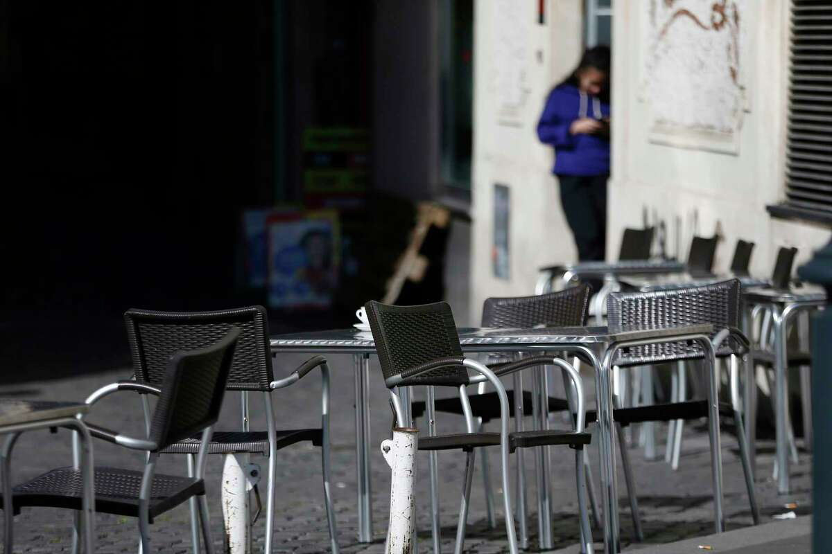 Chairs are empty at a cafe in Largo Argentina square amid growing concern about the spread of a new coronavirus in Rome Saturday, March 7, 2020. Italy is taking an almighty hit to its already weak economy from being the focal point of the coronavirus emergency in Europe. (Cecilia Fabiano/LaPresse via AP)