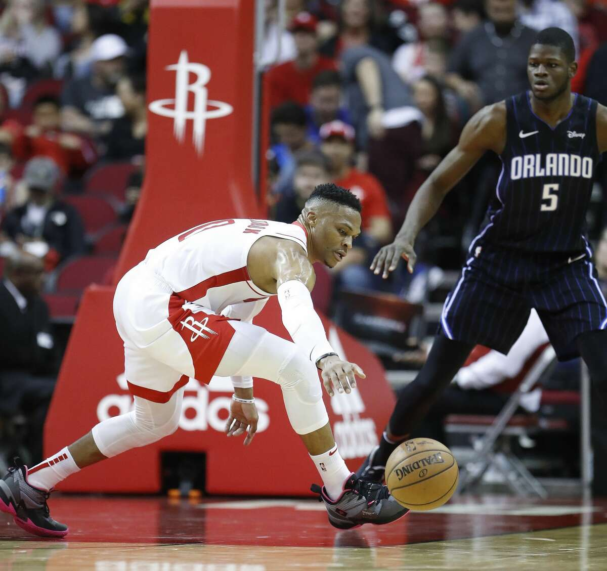 Houston Rockets guard Russell Westbrook (0) reaches for a loose ball against Orlando Magic center Mo Bamba (5) during the first half of an NBA basketball game, in Houston,Sunday, March 8, 2020.