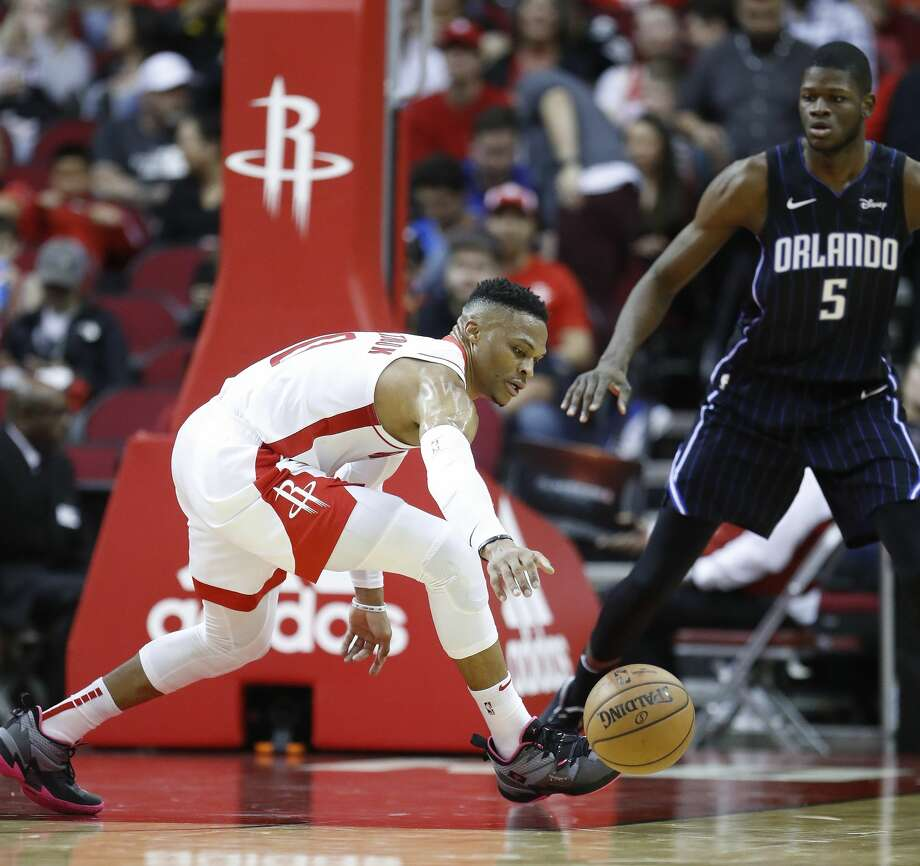 Houston Rockets guard Russell Westbrook (0) reaches for a loose ball against Orlando Magic center Mo Bamba (5) during the first half of an NBA basketball game, in Houston,Sunday, March 8, 2020. Photo: Karen Warren/Staff Photographer
