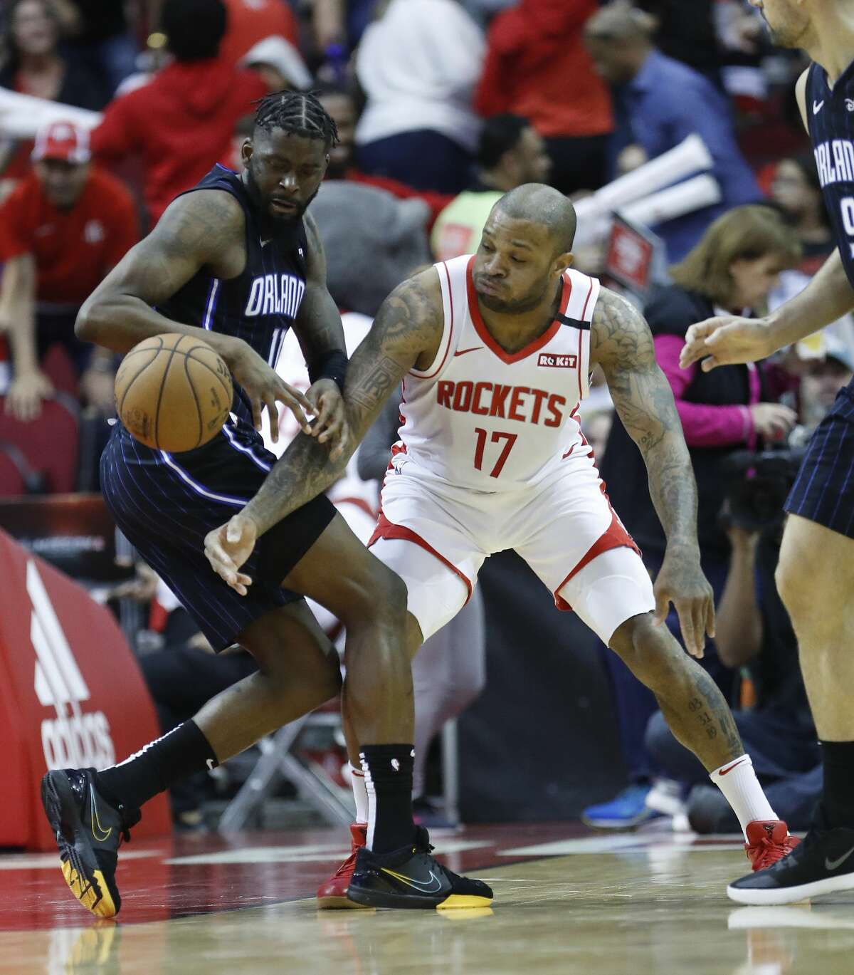 Orlando Magic forward James Ennis III (11) and Houston Rockets forward P.J. Tucker (17) chase a loose ball during the second half of an NBA basketball game, in Houston,Sunday, March 8, 2020.