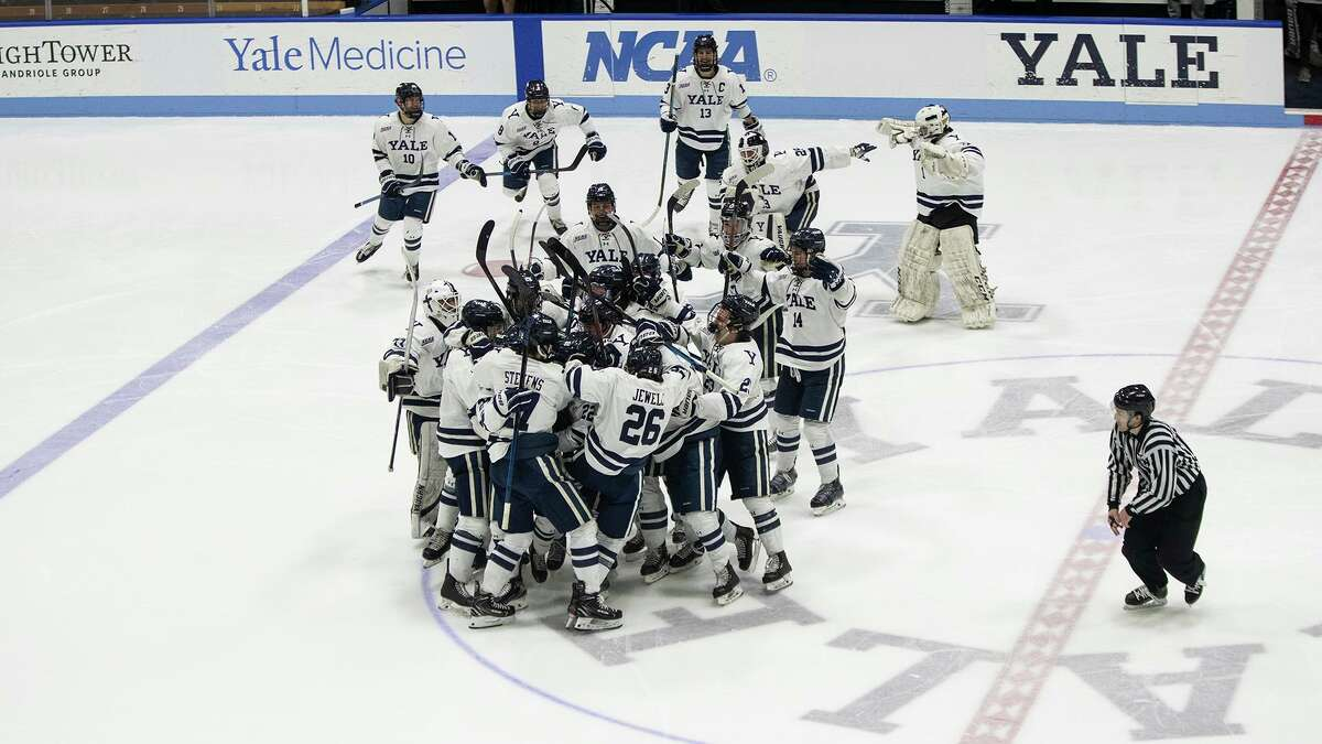 Yale players celebrate at center ice their 2-1 two overtime victory over Union on Sunday.
