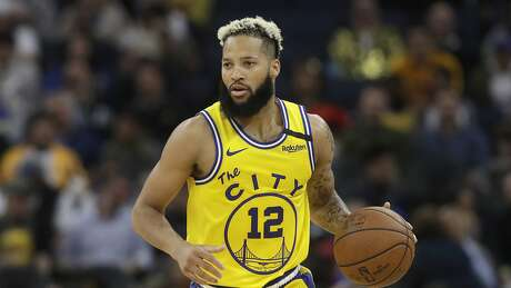 Golden State Warriors guard Ky Bowman (12) against the Los Angeles Lakers during an NBA basketball game in San Francisco, Thursday, Feb. 27, 2020. (AP Photo/Jeff Chiu)