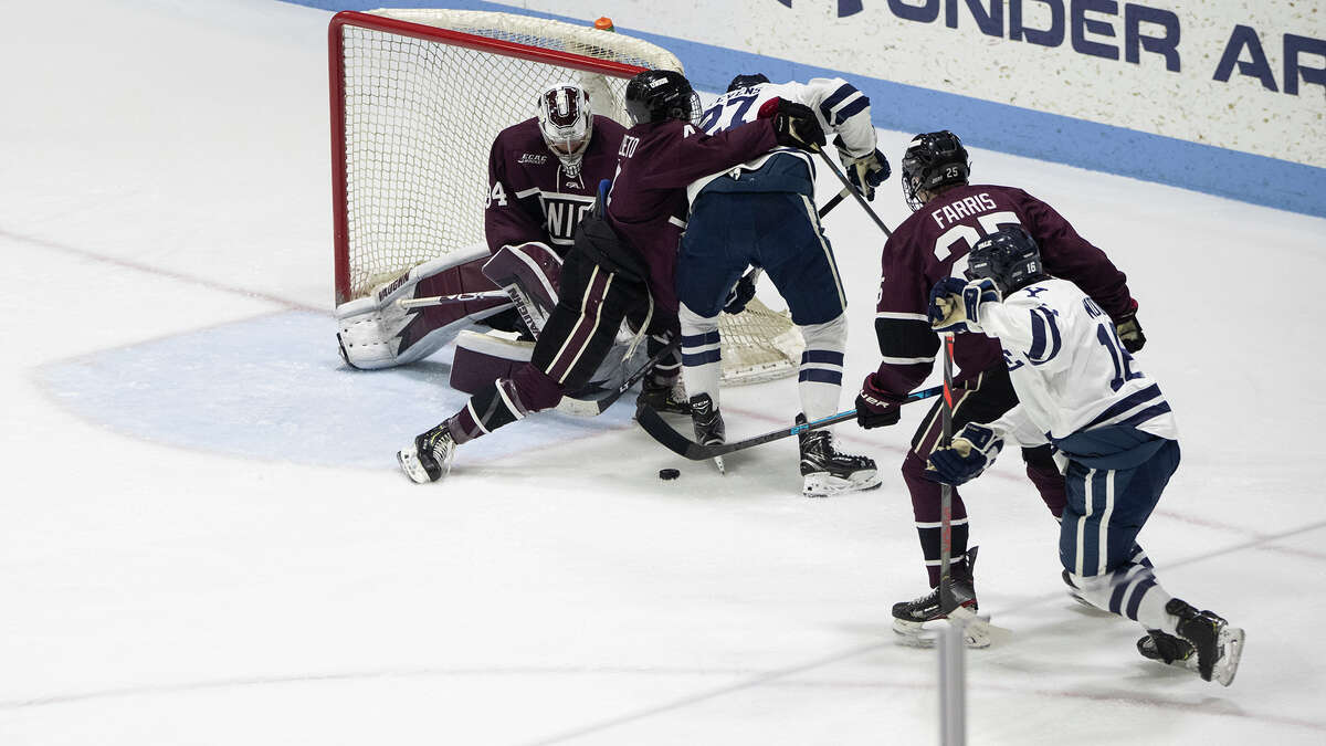 Union defenseman Joseph Campolieto ties up Yale's Luke Stevens during a playoff game on Sunday, March 8, 2020. (Steve Musco / Special to the Times Union)