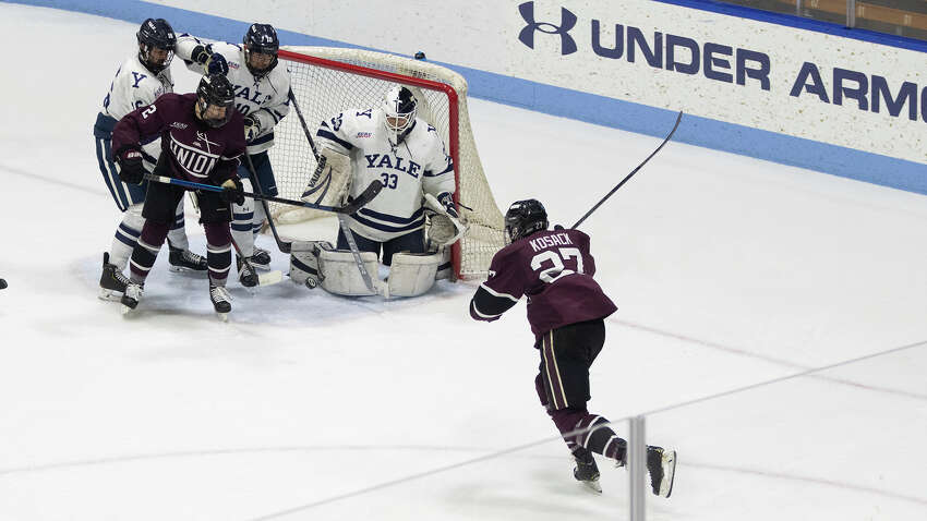 Josh Kosack with a backhand shot from in close during playoff game against Yale on Sunday, March 8, 2020. (Steve Musco / Special to the Times Union)