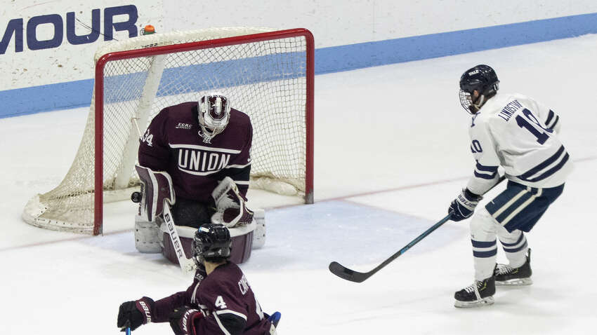 Union goaltender Darion Hanson just gets his blocker on a Yale shot from the point during a playoff game against Yale on Sunday, March 8, 2020. (Steve Musco / Special to the Times Union)