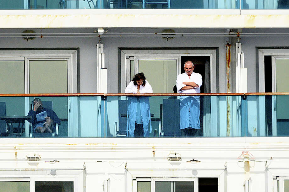 Passengers look out from balconies aboard the Grand Princess as it cruises a holding pattern about 25 miles off the coast of San Francisco on Sunday, March 8, 2020. The ship is expected to dock in Oakland in the east San Francisco Bay on Monday. California Gov. Gavin Newsom and the mayor of Oakland sought Sunday to reassure the public that none of the passengers from the ship with multiple cases of the new coronavirus will be released into the public before undergoing a 14-day quarantine. (AP Photo/Noah Berger) Photo: Noah Berger/AP