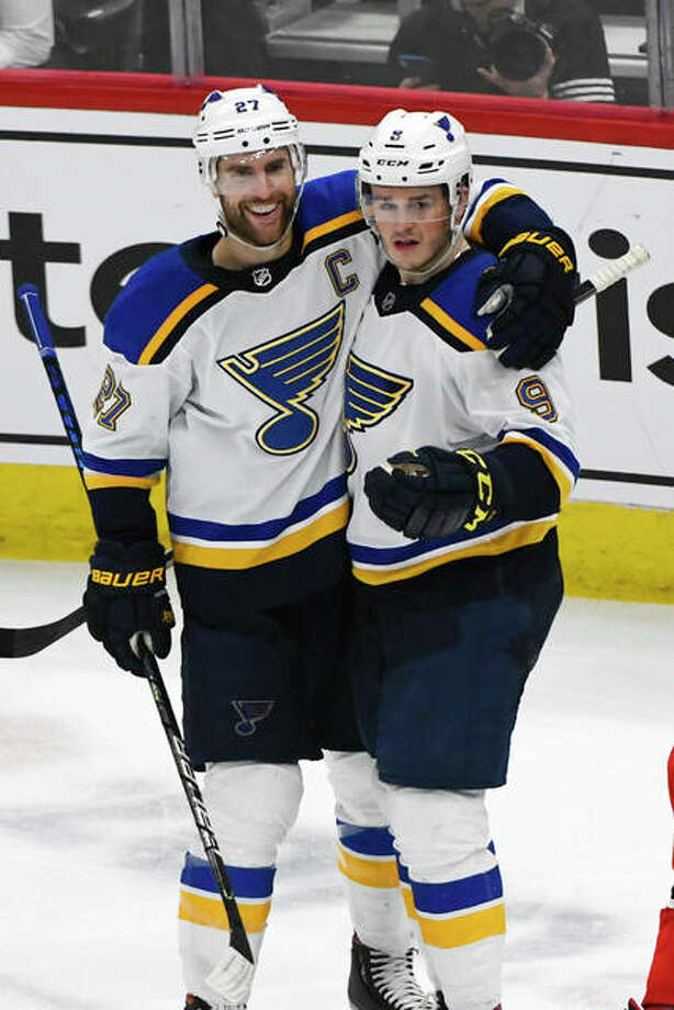 Blues defenseman Alex Pietrangelo (left) celebrates with winger Sammy Blais after Pietrangelo scored a goal against the Blackhawks during the third period Sunday in Chicago. Photo: Associated Press