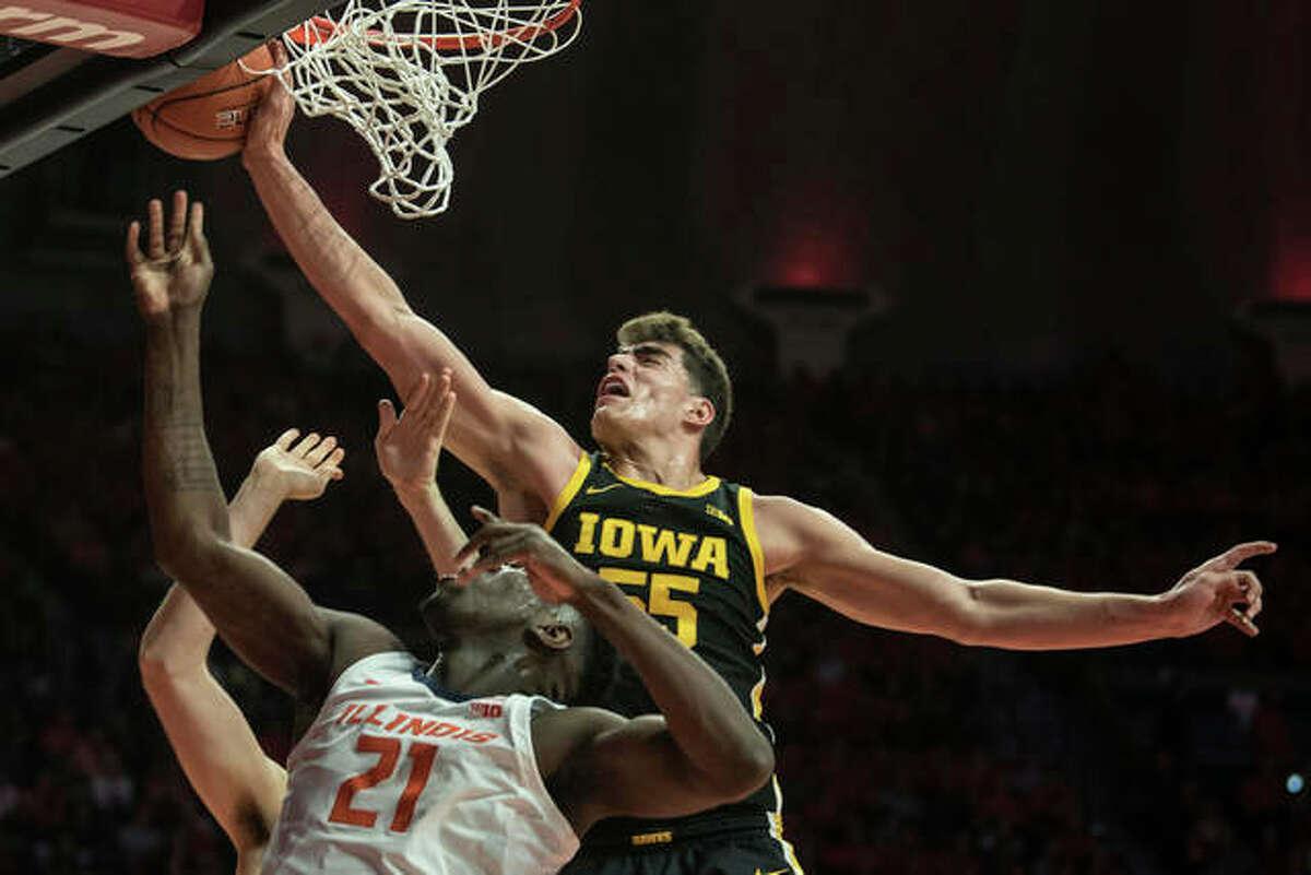 Iowa's Luca Garza blocks the shot of Illinois' Kofi Cockburn (21) in the first half Sunday in Champaign.