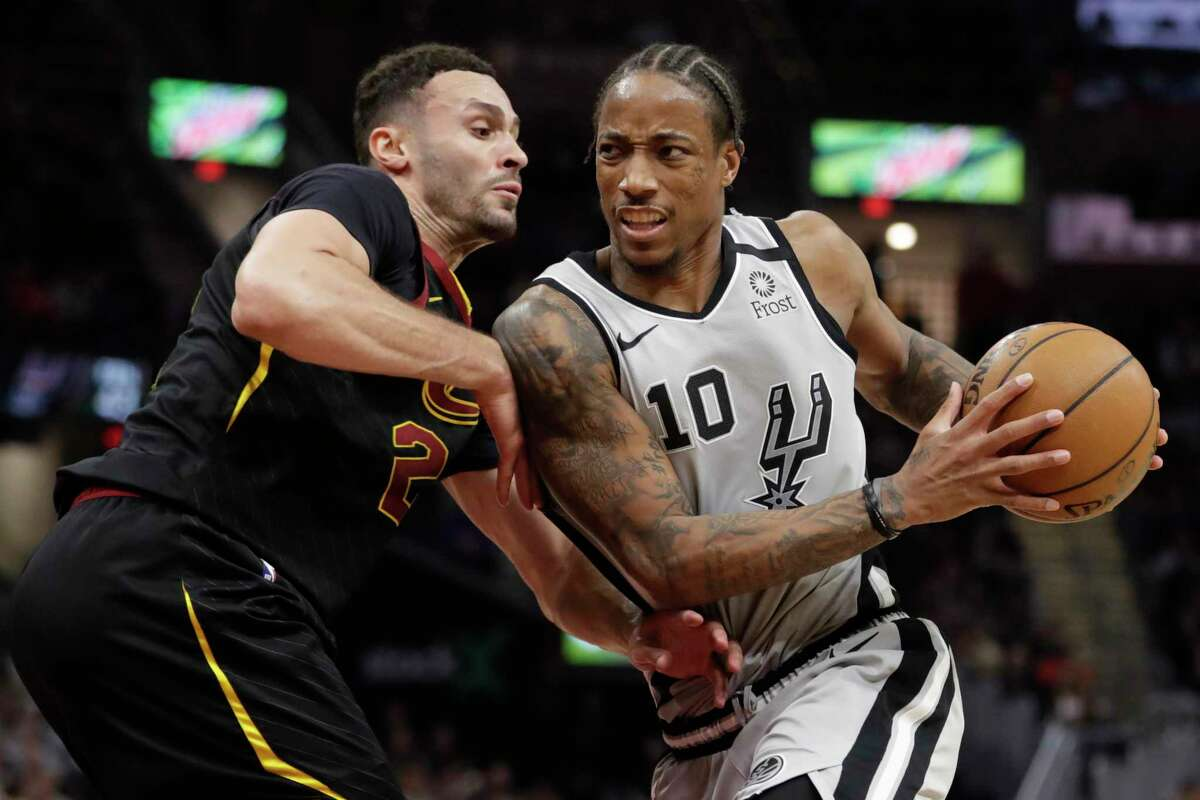The Spurs' DeMar DeRozan, who had a team-high 25 points in 42 minutes, drives against the Cavaliers' Larry Nance Jr. in the second half on Sunday.