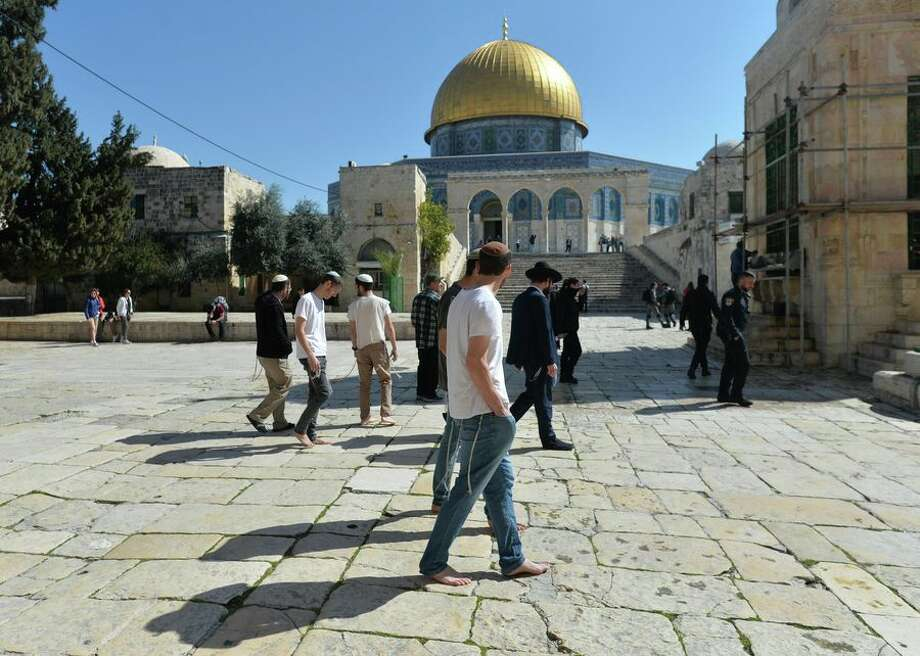 Tourists outside the Dome of the Rock mosque in Jerusalem. Israel closed its land border with Egypt on March 8 due to the spread of the coronavirus. Photo: CBSI/CNET