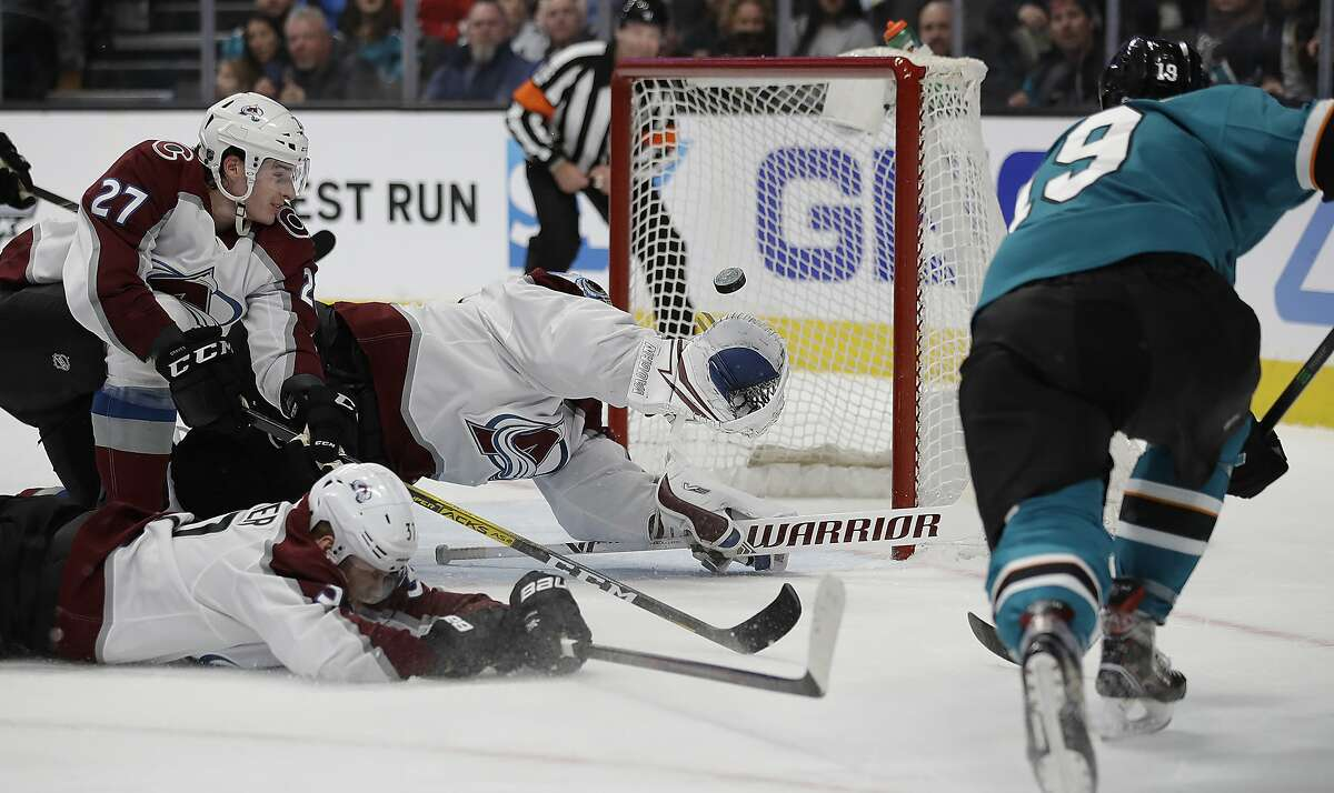 San Jose Sharks' Joe Thornton, right, scores a goal past Colorado Avalanche goalie Pavel Francouz, second from right, and Ryan Graves (27) during the first period of an NHL hockey game Sunday, March 8, 2020, in San Jose, Calif. (AP Photo/Ben Margot)