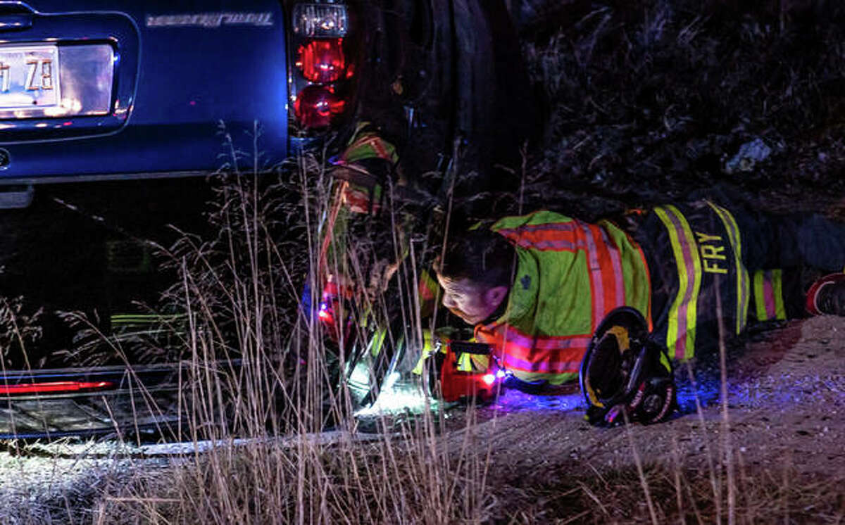 ALTON - Alton firefighters worked to extricate an injured man Sunday night after the Chevy Trailblazer he was driving left Berm Highway near Locks and Dam Way, and plunged approximately 20 feet into a water retention area on the north side of the road, coming to rest upside-down in dry brush. The incident occurred at approximately 9:45 p.m. It took rescue crews about 20 minutes free the driver, who was then transported by ambulance to an Alton hospital in a stable condition, with non-life threatening injuries.