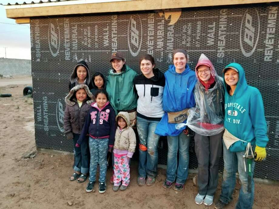 Members of His House Christian Fellowship, a registered student organization at Ferris State University, pose with the family who received a home in Ciudad Juarez, Mexico, built during spring break 2019. Big Rapids' Wesley House and the Newman Center campus ministry also have spring break outreach plans in New Orleans and Chicago, respectively. (Courtesy photo)