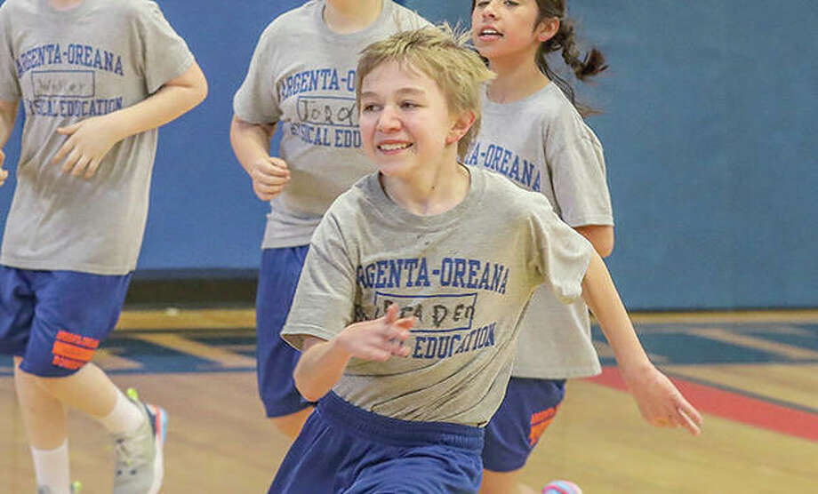 Sixth-grader Braden McCosky runs during a physical education class in the gym at Argenta-Oreana Middle School. Photo: Clay Jackson | Herald & Review (AP)
