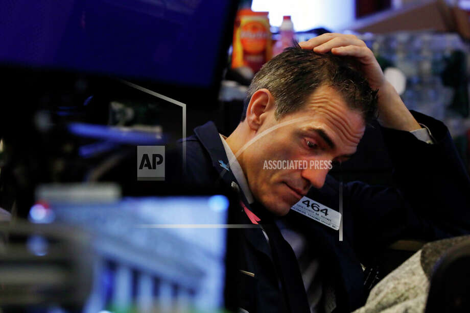 Trader Gregory Rowe prepares for the day's activity on the floor of the New York Stock Exchange, Monday, March 9, 2020. Trading in Wall Street futures has been halted after they fell by more than the daily limit of 5 percent. Photo: Richard Drew/AP / Copyright 2019 The Associated Press. All rights reserved