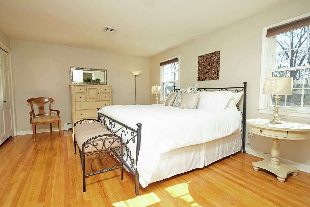 This house features four bedrooms. The master suite has closets with organizers and an updated private bath.