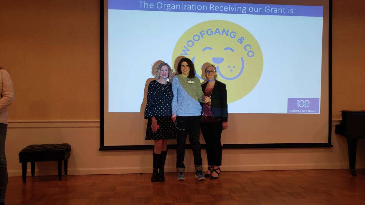 Woofgang & Co. representatives, along with Darien resident Grace Wohlberg (middle).