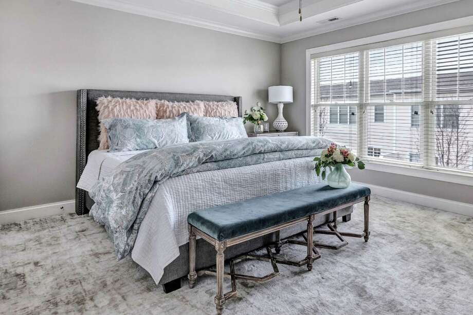 Debbie Sippel, owner of Fairfield-based Design by Debra Sippel LLC, worked with her client to create this spa-like space using quality linens, a soothing color palette, luxurious carpet, and accessories to make it both feminine and comfortable. Photo: Anna Guzzi Photography / / Connecticut Post